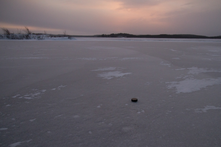 hockey puck on frozen lake