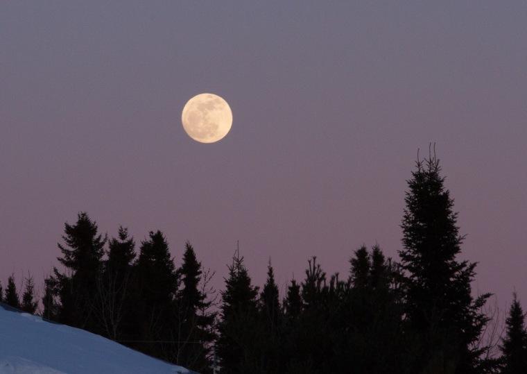 near full moon at sunset