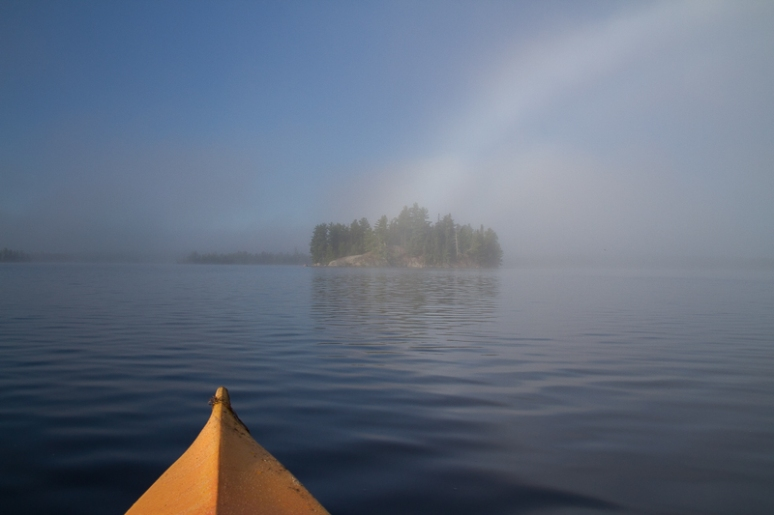 kayak to island with arch of fog